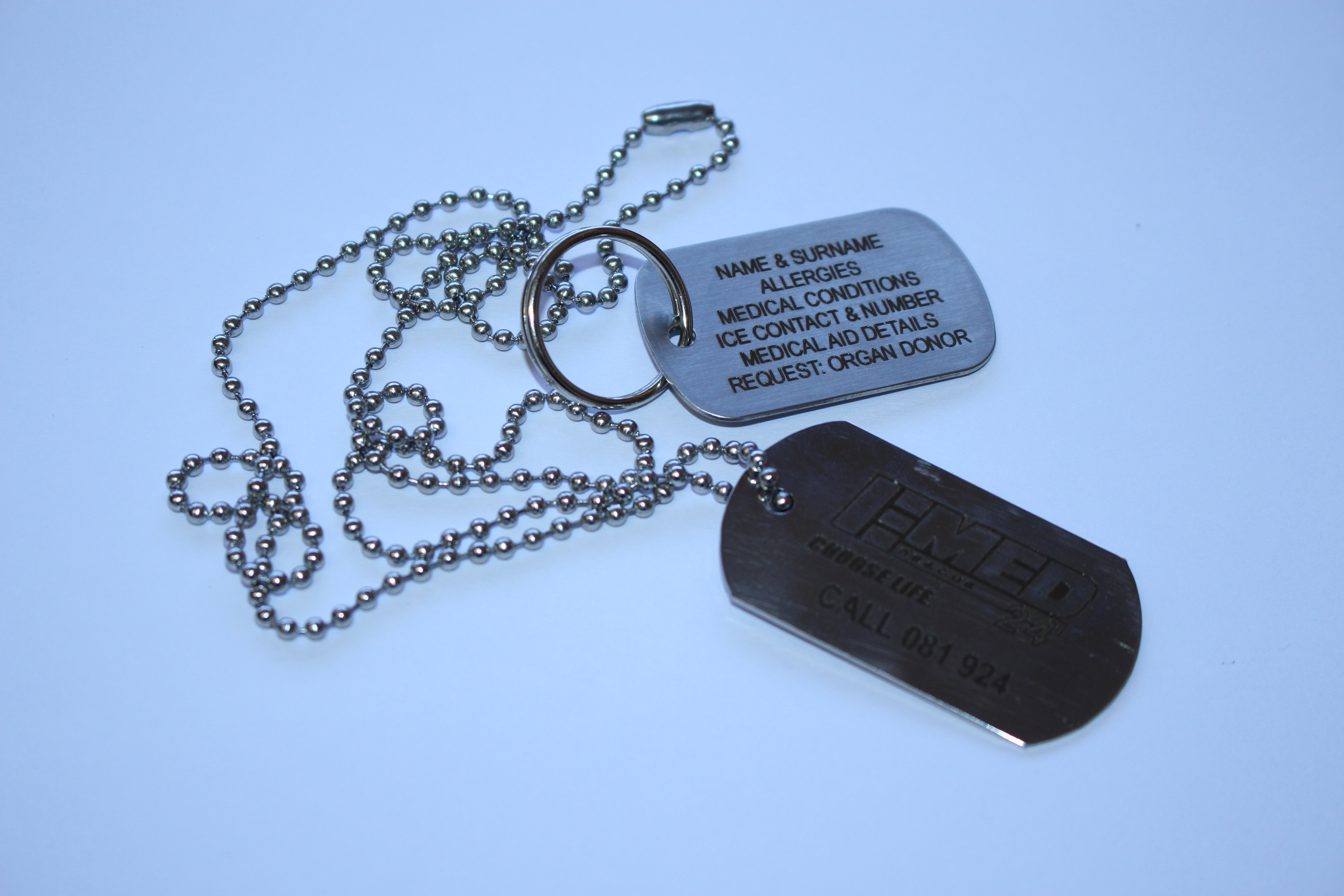 DOG TAG/KEY RING Polished/Brushed, Stainless Steel Grade 316 plate with a ball chain of 70cm in length. - Available in Medium and Large. - Large: Additional cost of N$ 10.00